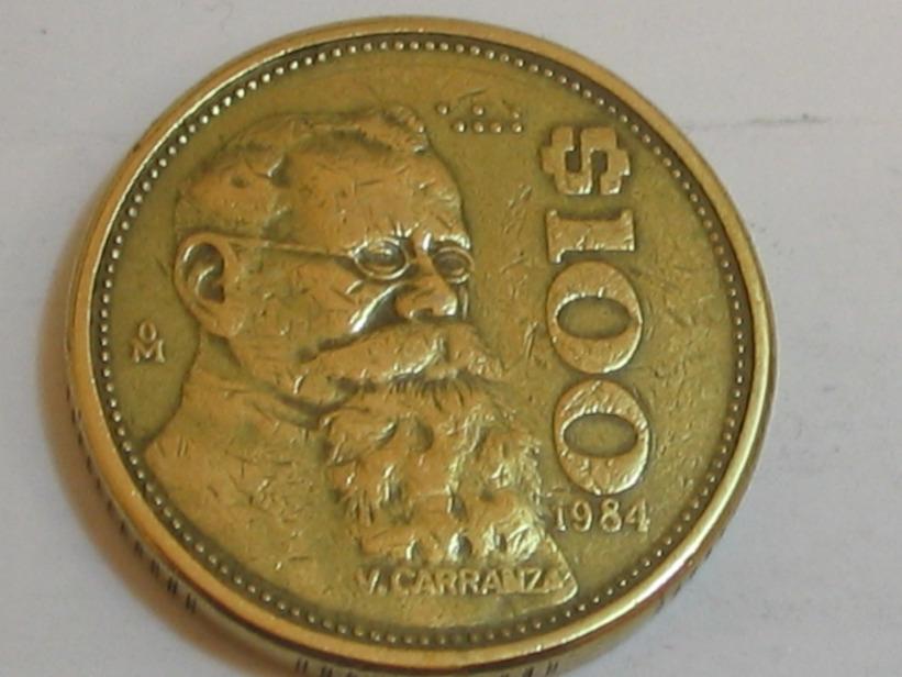 Moneda de 100 pesos con rostro de Venustiano Carranza
